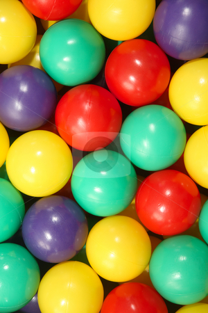 Close up background of colorful plastic play balls. stock photo, Close up background of colorful plastic play balls. by Stephen Rees