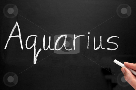 The star sign Aquarius written on a blackboard. stock photo, The star sign Aquarius written on a blackboard. by Stephen Rees