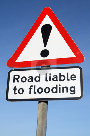 Road liable to flooding warning sign and a blue sky. stock photo, Road liable to flooding warning sign and a blue sky. by Stephen Rees