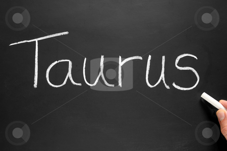 The star sign Taurus written on a blackboard. stock photo, The star sign Taurus written on a blackboard. by Stephen Rees