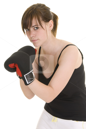 Teenage girl doing sport stock photo, Teenage girl with black and white outfit, wearing boxing gloves, in various positions for boxing or martial arts. by Nicolaas Traut