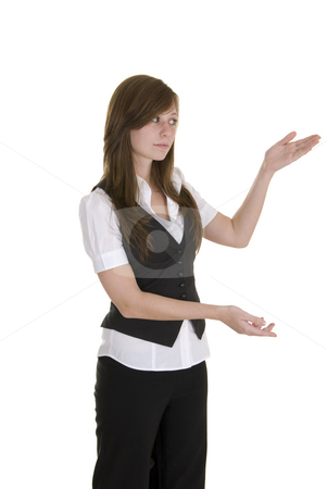 Young business lady indicating stock photo, Young lady in black and white business attire on white background, indicating and smiling. by Nicolaas Traut