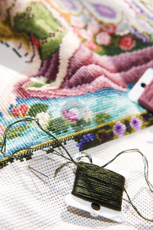 Cross stitch art in the making stock photo, Colorful cross stitch art in the making, showing various color threads. by Nicolaas Traut