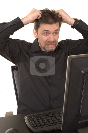 Angry man looking at computer stock photo, Angry man looking at the computer screen with a look of horror on his face, pulling his hair out. Background is white isolated. by Nicolaas Traut