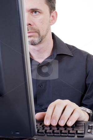 Man working on computer stock photo, A caucasian middle-aged man working on a computer, close up with white isolated background. by Nicolaas Traut