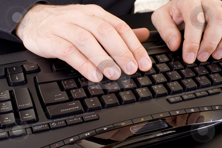 Hands on keyboard stock photo, Caucasian male hands on a keyboard. by Nicolaas Traut