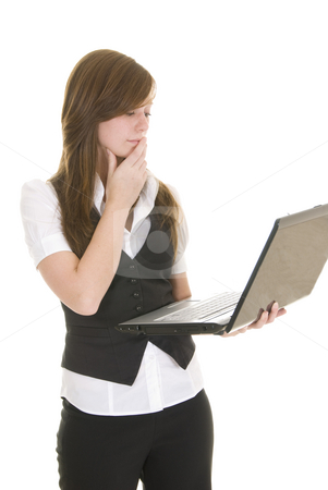 Young business lady with laptop stock photo, Young lady dressed in black and white business attire isolated on white background, holding a laptop computer. by Nicolaas Traut