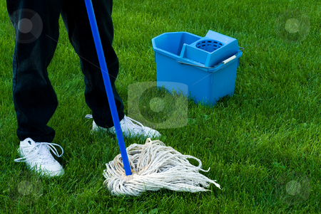 Cleaning The Earth stock photo, Somebody using a mop and pail to clean up the Earth by Richard Nelson