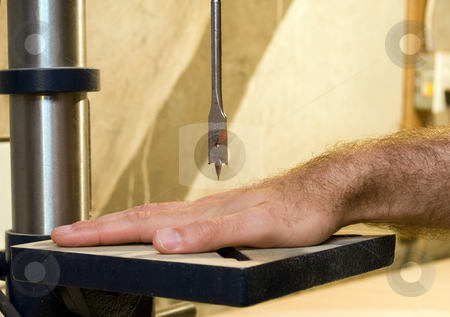 Drill Press Accident stock photo, A hand under a drill press, symbolizing work safety by Richard Nelson