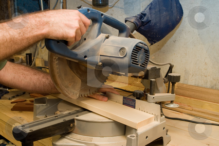 Saw Accident stock photo, Somebody about to get their thumb cut off from a power saw by Richard Nelson