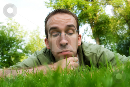 Relaxing stock photo, A young man lying in the grass, relaxing by Richard Nelson