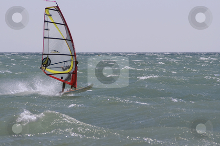 Windboard stock photo, Windboarder at full speed during a windy day in Mediterranean sea. by Serge VILLA
