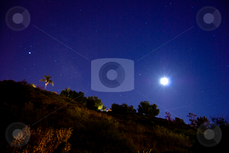 Starry Night stock photo, Moonlight illuminating a remote landscape in Orange County. by Peter Bruenner