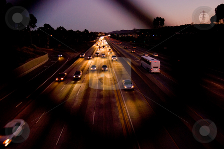 Golden Freeway stock photo, Freeway bathed in gold by car headlights. by Peter Bruenner
