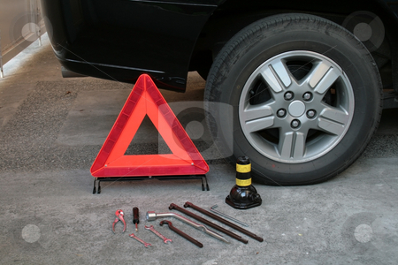 Travel safety preparation stock photo, Early warning device with tire changing tools by Jonas Marcos San Luis