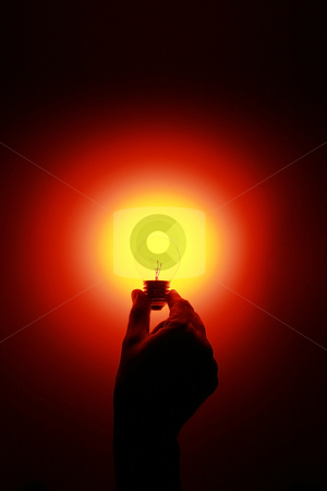 Hot idea stock photo, A hand holding a glowing red light bulb by Jonas Marcos San Luis