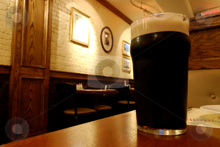 Glass of beer  stock photo, Glass of beer at the pub by Gady Cojocaru