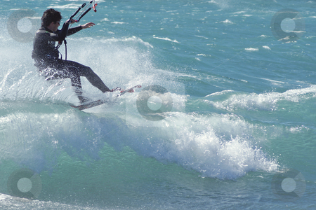 Kiteboarder on the wave stock photo, Kiteboarder at the top of a wave during a windy day in French Riviera by Serge VILLA