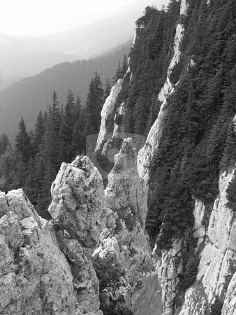 Mountains in Transylvania stock photo, Mountains in Romania, from unusual viewpoint. Black and white coloring draws all attention to the great altitude. by Gyozo Toth
