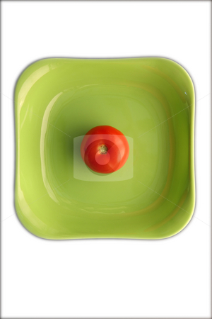 Tomato stock photo, Red tomato in green dish. by Gyozo Toth