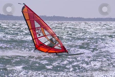 Windsurfer stock photo, Windsurfer at full speed during a windy day i Mediterranean sea by Serge VILLA