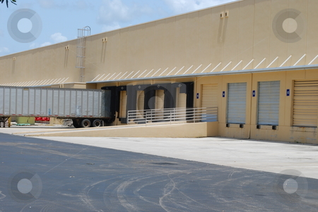 Loading Docks stock photo, Warehouse loading docks with trailer by Robert Cabrera
