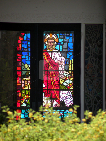 Jesus in the window stock photo, Stained glass window with the depiction of Jesus by Rob Wright