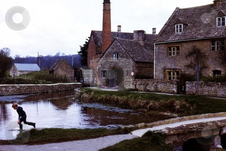 Running through the Water stock photo, Lower Slaughter, Cotswolds by Ray Roscoe