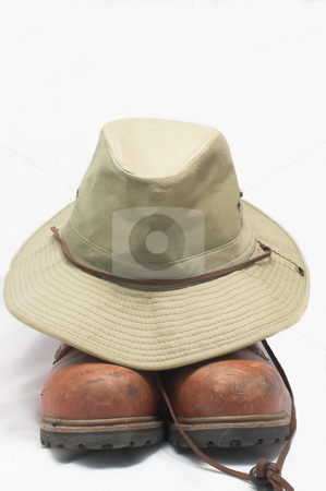 Safari Hat and Boots stock photo, A safari type hat and a pair of hiking boots. by Robert Byron