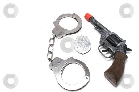 Law Enforcement Equipment stock photo, Toy replicas of law enforcement equipment. by Robert Byron