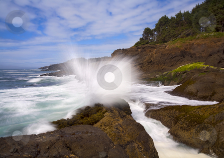 Explosive stock photo, A wave crashes over a rock shelf along the ORegon coast near Depoe Bay by Mike Dawson