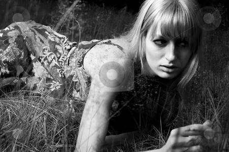 Lay down on the grass stock photo, Young blond woman wearing a dress in the forest by Frenk and Danielle Kaufmann