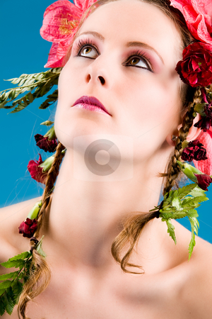 Cosmetic flower girl stock photo, Young woman with big flowers in her hair by Frenk and Danielle Kaufmann