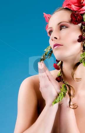 Flowergirl looking up stock photo, Young woman with big flowers in her hair by Frenk and Danielle Kaufmann