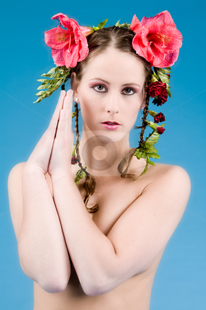 Pretty flower girl stock photo, Young woman with big flowers in her hair by Frenk and Danielle Kaufmann