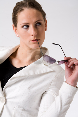 Young woman looking at a view stock photo, Young sturdy woman with sunglasses on a white background by Frenk and Danielle Kaufmann