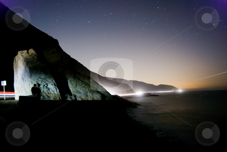 Malibu Midnight stock photo, A young couple enjoying a quiet summer night on the rocky coastline of North Malibu. by Peter Bruenner