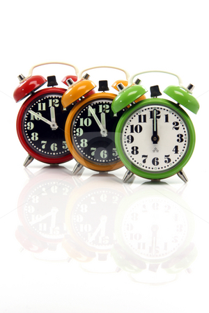 Alarm clocks vertical stock photo, Timing red yellow and green alarm clock untill twelve oclock closeup with nice  reflection vertical by EVANGELOS THOMAIDIS