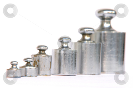 Different weights stock photo, Different weight units in a row focus on the small one isolated on white background by EVANGELOS THOMAIDIS