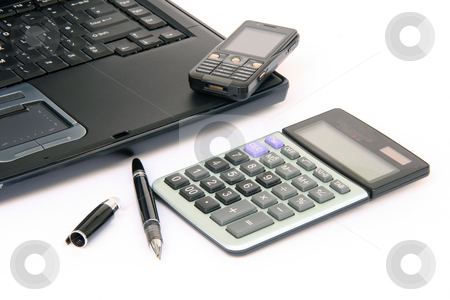Business stock photo, Laptop detail with pen cellphone and calculator isolated on white background by EVANGELOS THOMAIDIS