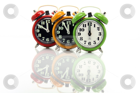 Before twelve reflection stock photo, Timing red yellow and green alarm clock untill twelve oclock closeup with nice reflection by EVANGELOS THOMAIDIS