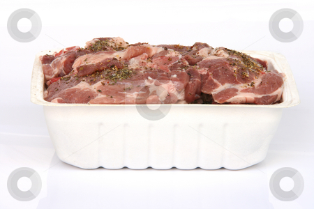 Chops in bowl stock photo, Ready for BBQ raw pork chops in bowl with oregano isolated by EVANGELOS THOMAIDIS