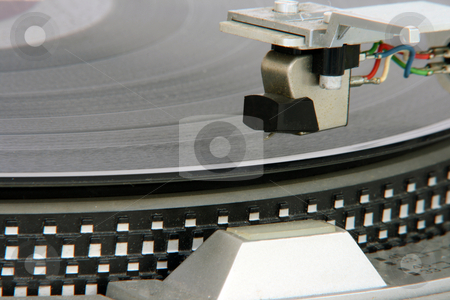 Turntable cartridge stock photo, Closeup of old turntable with long play vinyl by EVANGELOS THOMAIDIS