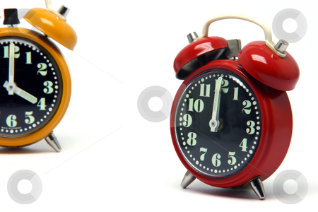 Orange and red clock stock photo, Red and orange color alarm clock at twelve oclock isolated on white background by EVANGELOS THOMAIDIS