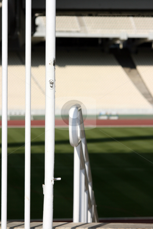 Gate and stadium stock photo, Stadium gate detail with  blur tiers and field in background by EVANGELOS THOMAIDIS