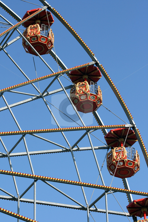 Detail  spinning wheel stock photo, Detail from big spinning wheel at amusement park and blue sky background by EVANGELOS THOMAIDIS