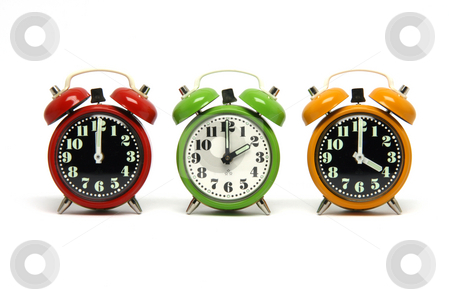 Alarm clocks stock photo, Three classic small alarm clocks isolated on white background by EVANGELOS THOMAIDIS