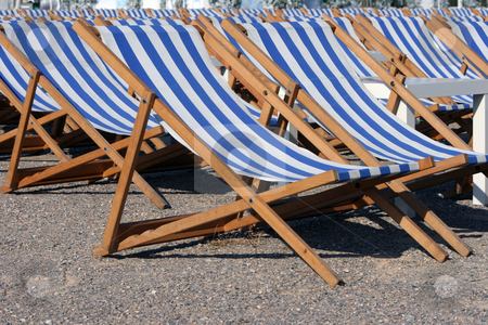 Chaise longues closeup stock photo, Blue and white chaise longues  and table closeup summer concepts by EVANGELOS THOMAIDIS