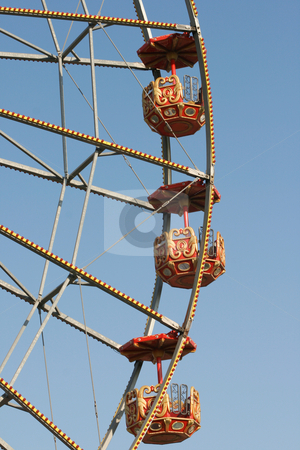 Wheel baskets stock photo, Detail from big ferris wheel baskets at amusement park and blue sky by EVANGELOS THOMAIDIS