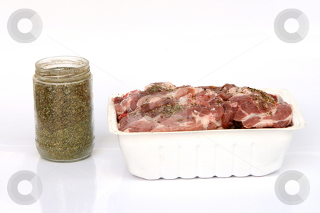 Ready for BBQ stock photo, Ready for BBQ raw pork chops in bowl and glass pot with oregano isolated by EVANGELOS THOMAIDIS